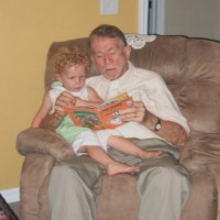 Dad reading to (Grand daughter)Alexandra
